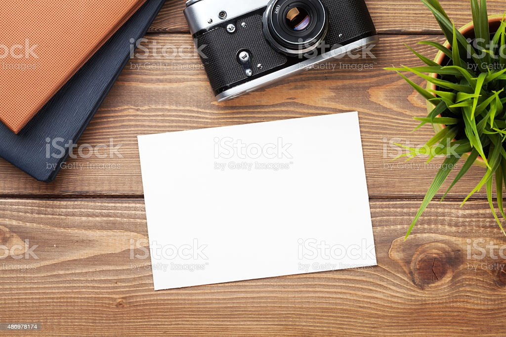 Blank photo frame, camera and supplies stock photo