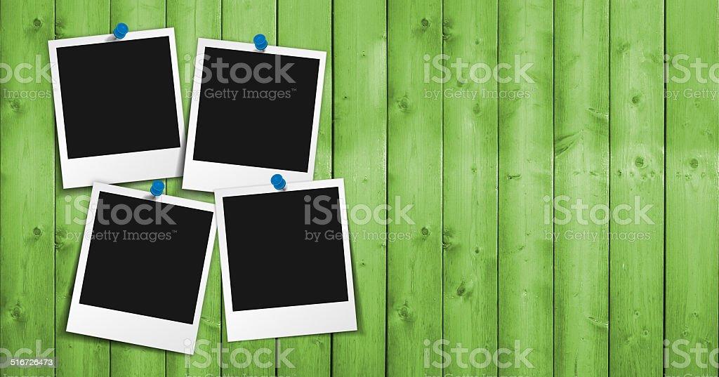 Blank Photo Frame On Green Wood stock photo