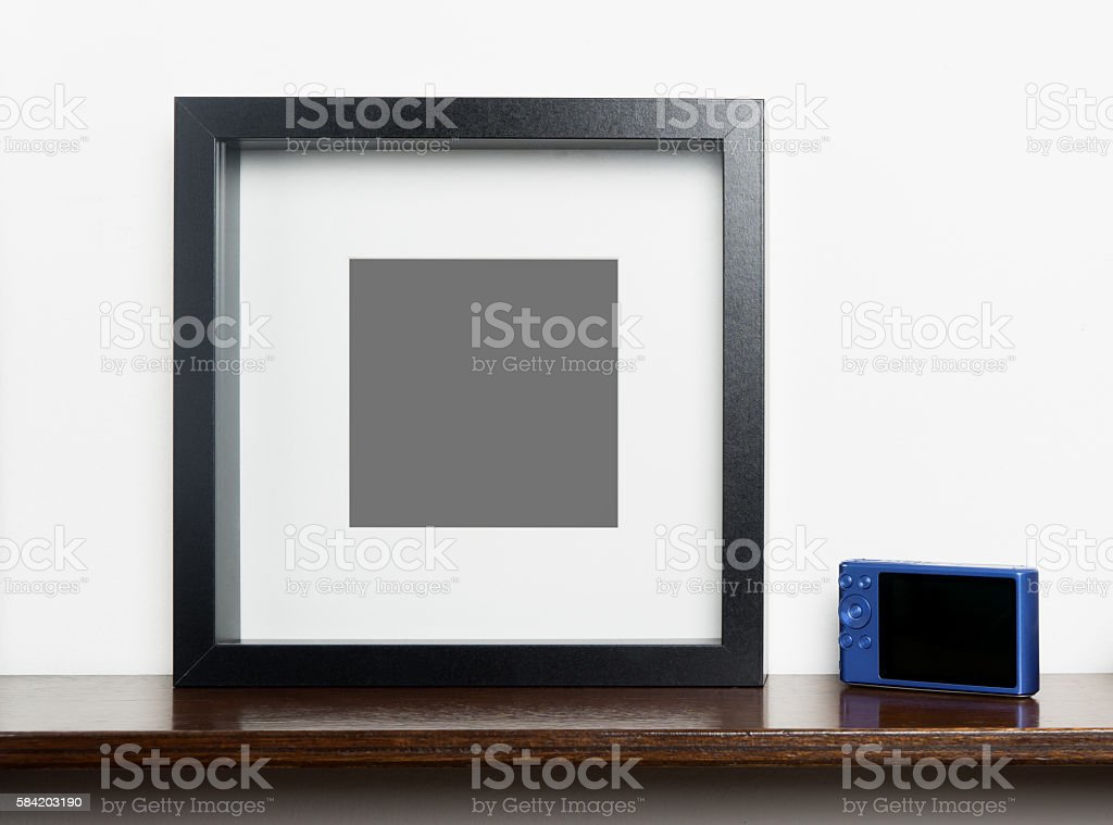 Blank photo frame with compact camera for memory picture stock photo