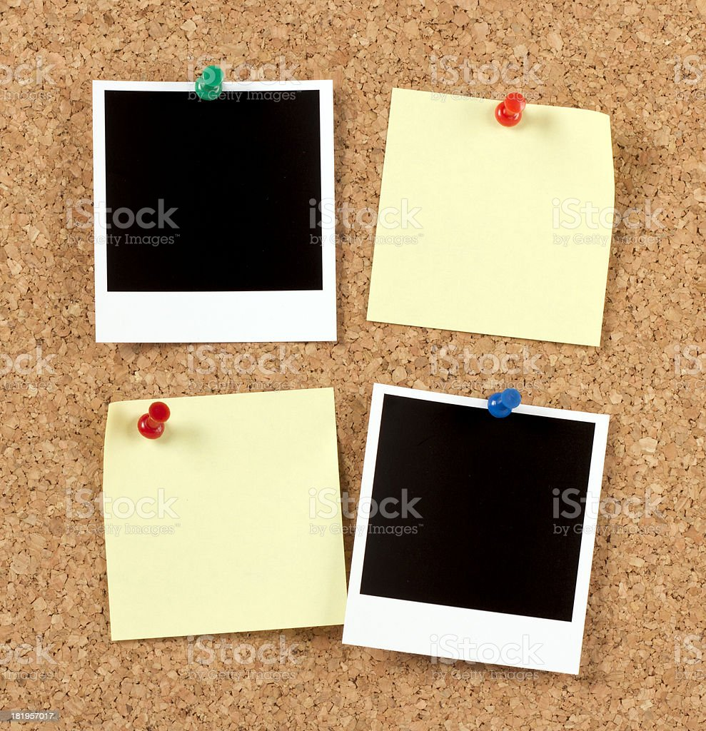 Blank Photo Papers with Post-it on Corkboard royalty-free stock photo