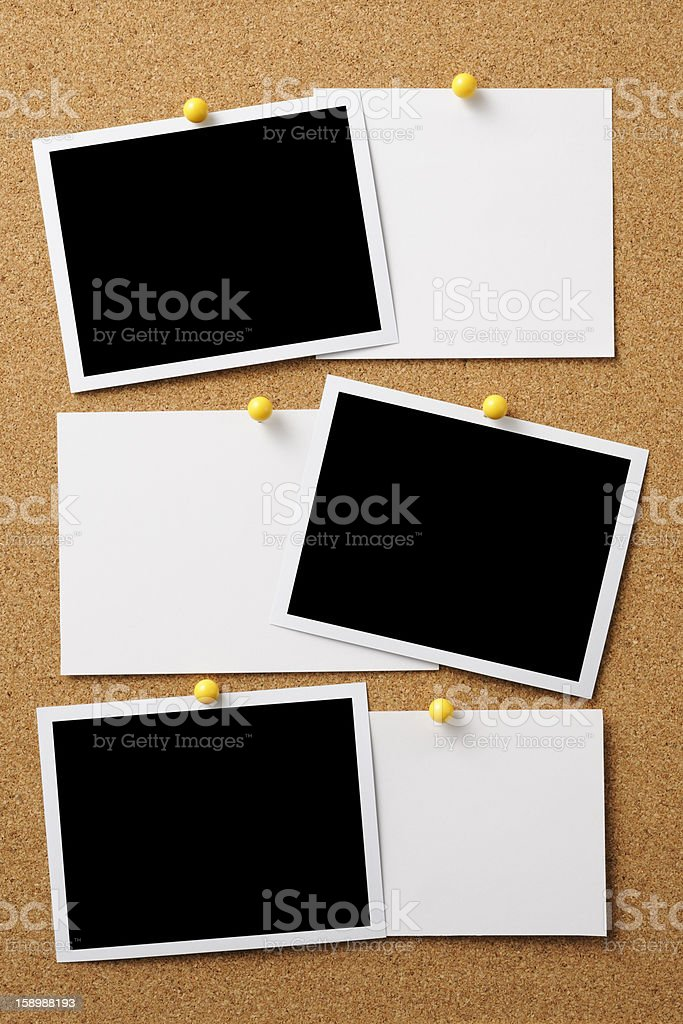 Blank photo with memo pinned on cork board stock photo