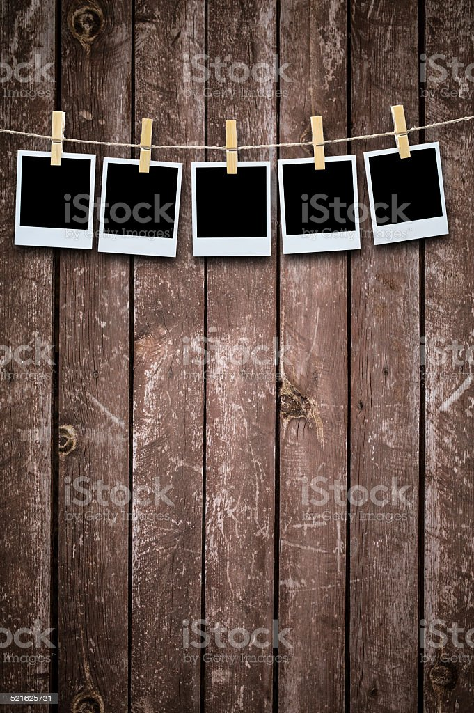 Blank photographs hanging on a clothesline stock photo