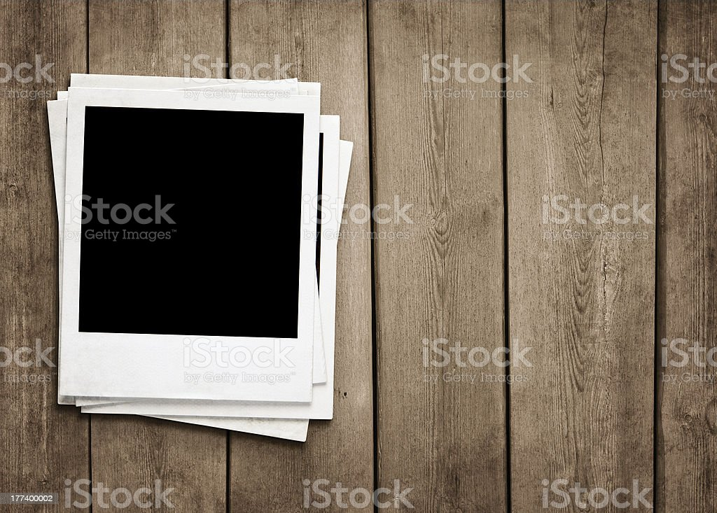 Blank photos at wooden background stock photo