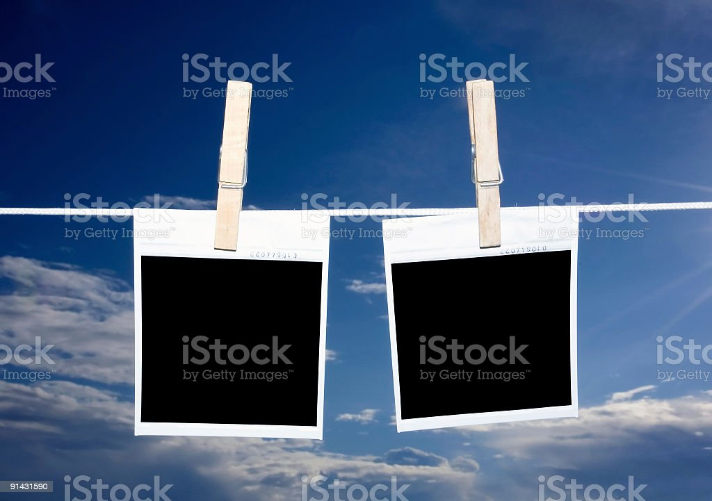 blank photos hanging in front of nice blue sky royalty-free stock photo
