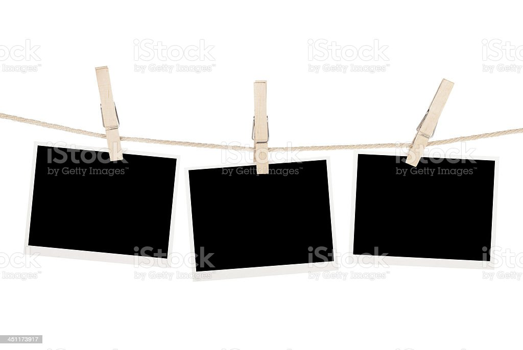 Blank photos hanging on clothesline stock photo