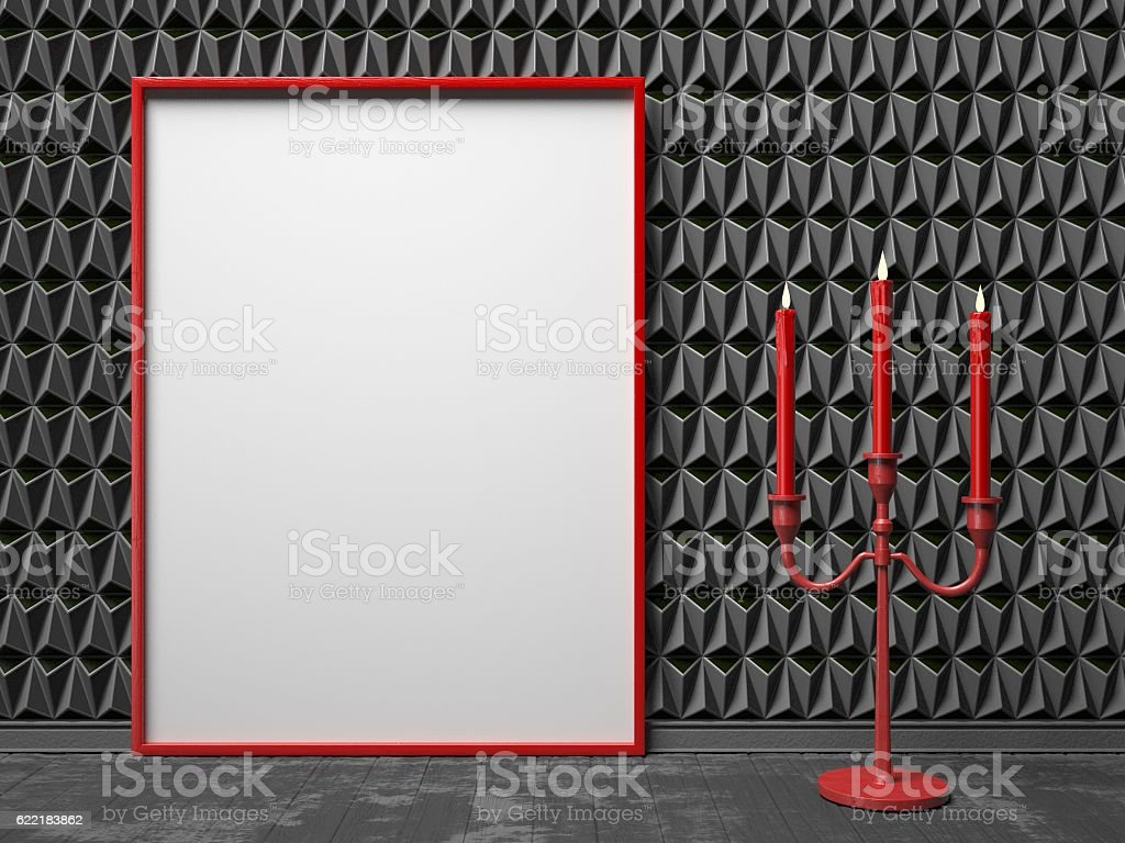 Blank picture frame and red candlestick on black triangulated ba stock photo