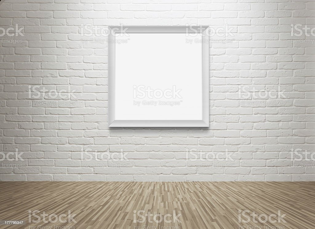 Blank picture frame at the wall stock photo