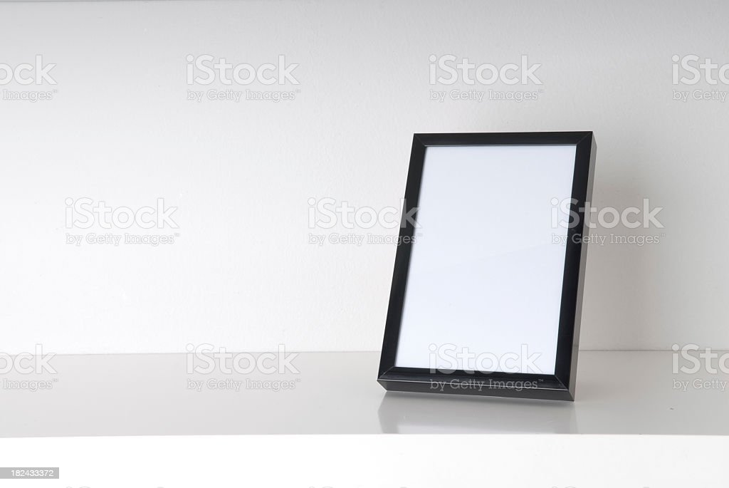 Blank picture frame on a white table with white background royalty-free stock photo