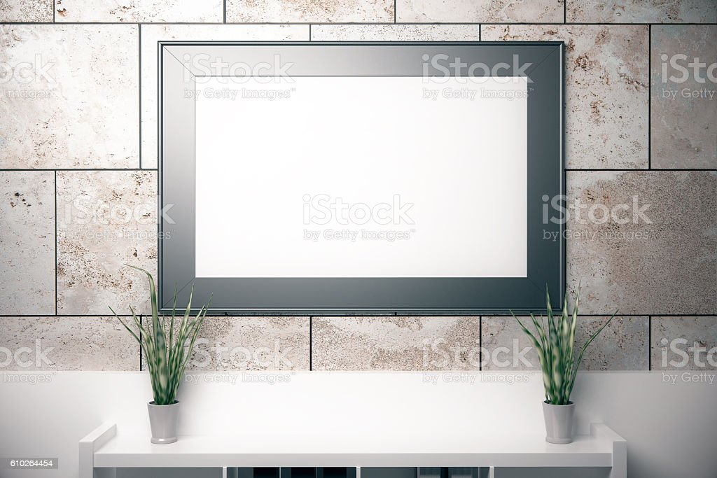 Blank picture frame on concrete tile stock photo