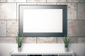 Blank picture frame on concrete tile