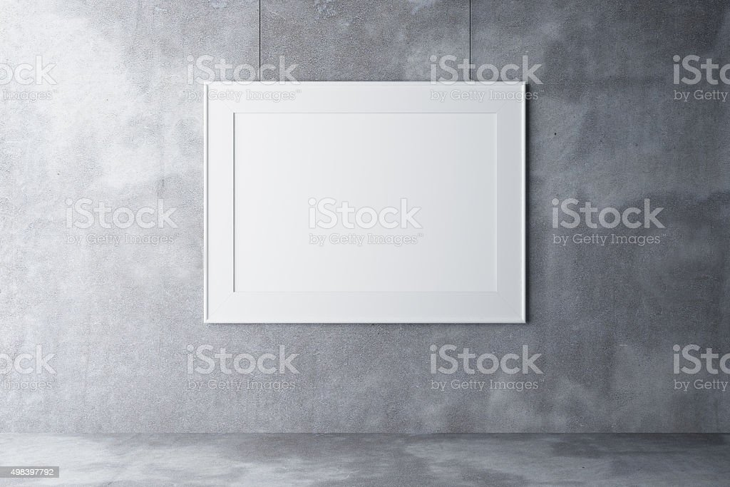 Blank picture frame on concrete wall stock photo