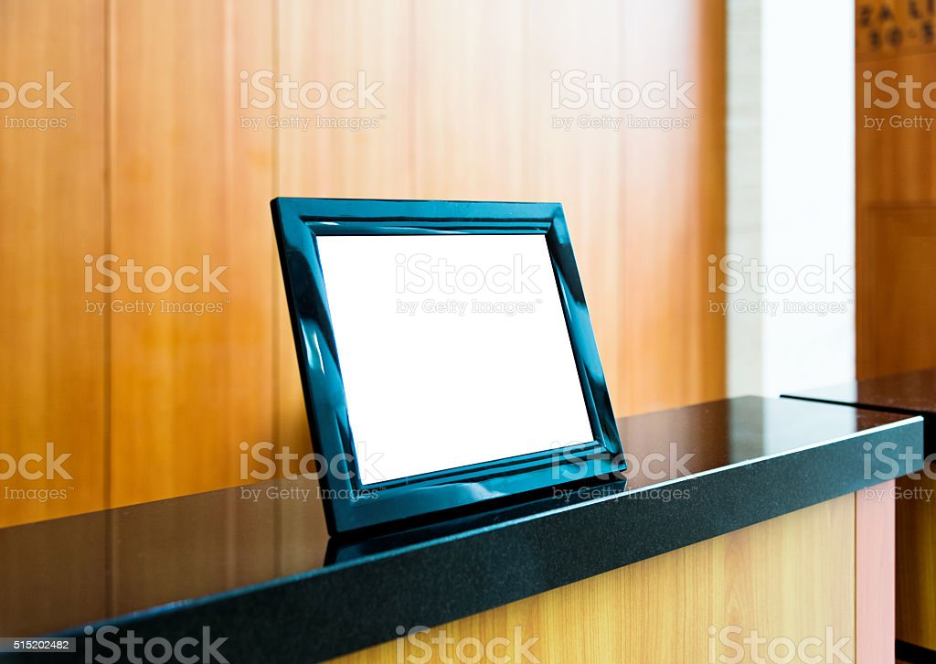 Blank picture frame on the table stock photo