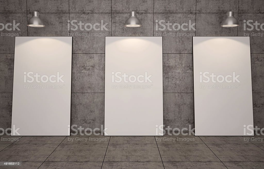 Blank picture frames on brick wall background. stock photo
