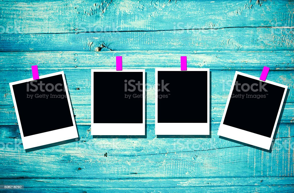 Blank picture frames on the blue wood stock photo
