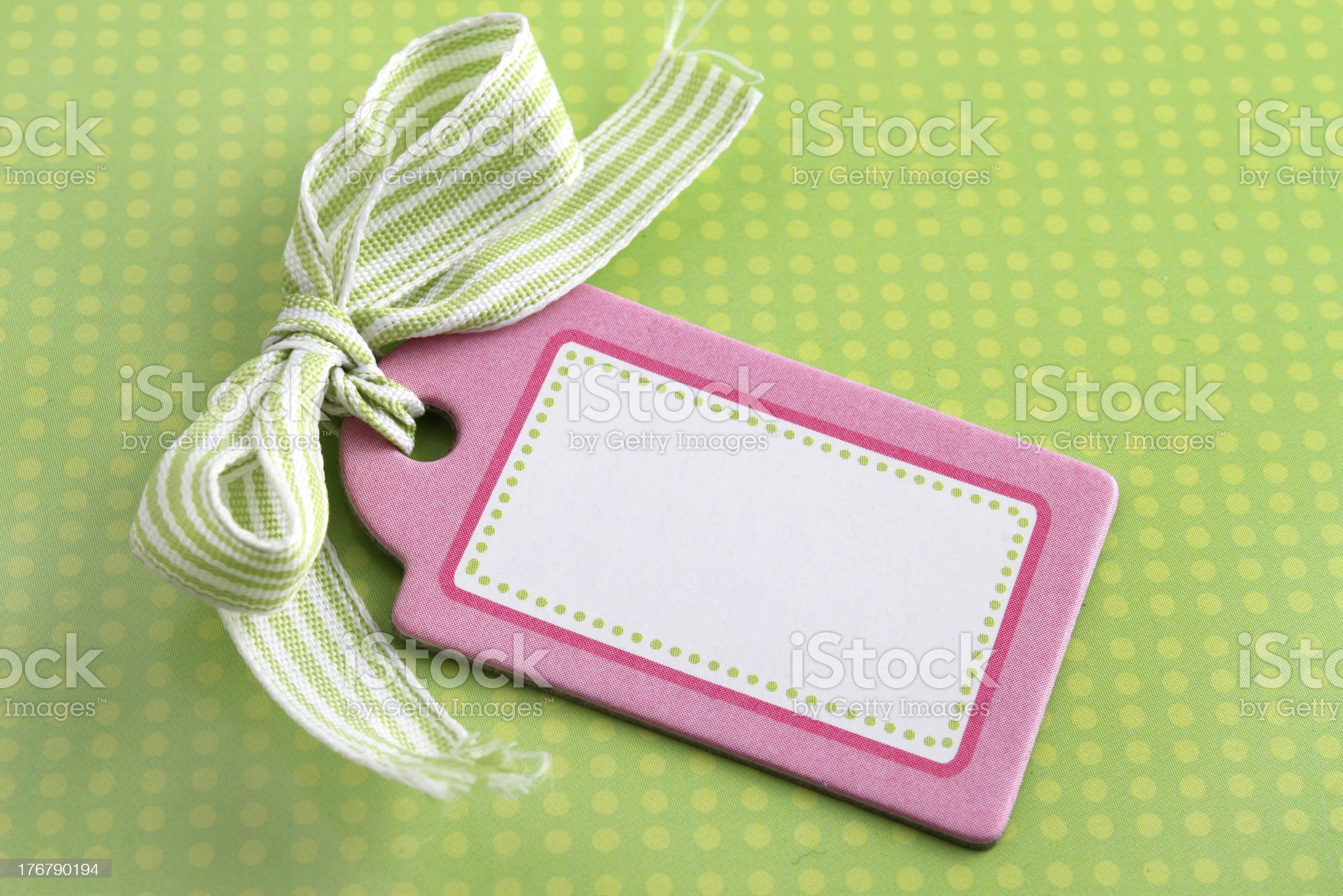 Blank pink tag on green royalty-free stock photo