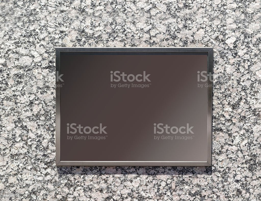 Blank Plaque on Granite Wall stock photo