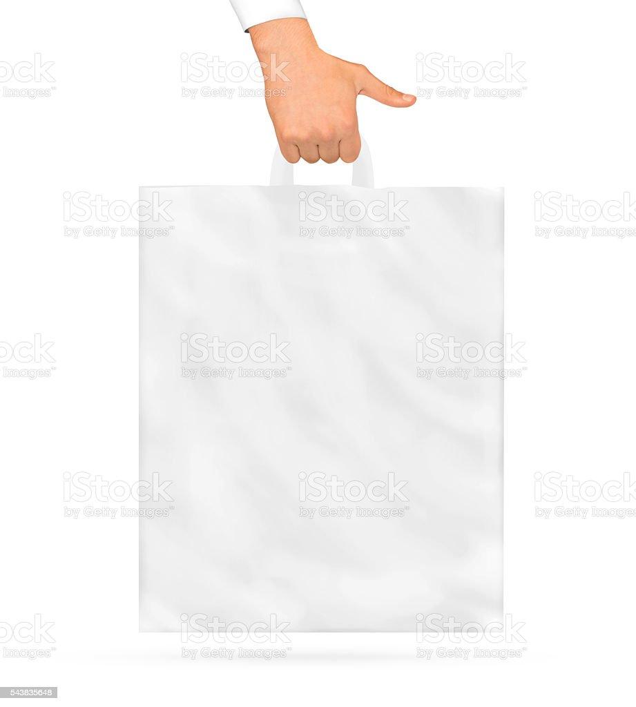 Blank plastic bag mock up holding in hand. Empty polyethylene stock photo