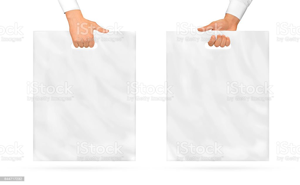 Blank plastic bag mock up holding in hand. Empty polyethylene stock photo