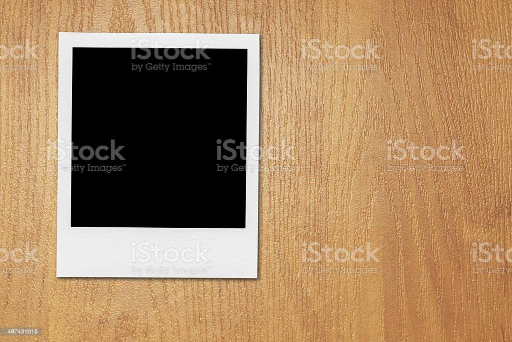 Blank Polaroid Photo Frame On The Desk. stock photo
