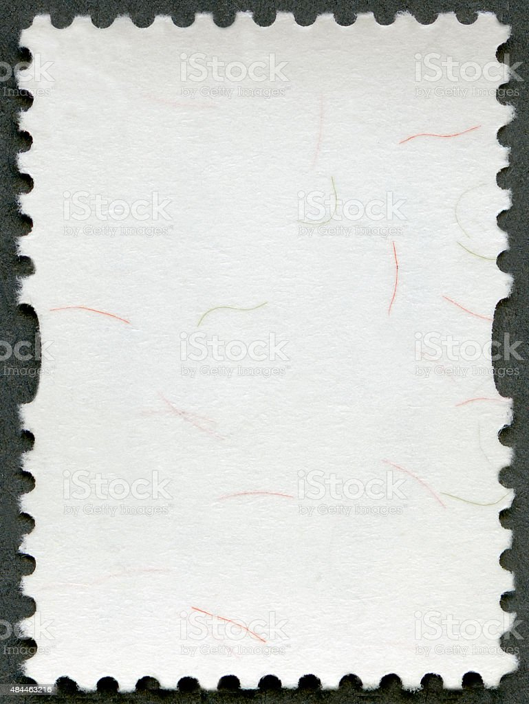 Blank postage stamp sheet on a black background stock photo