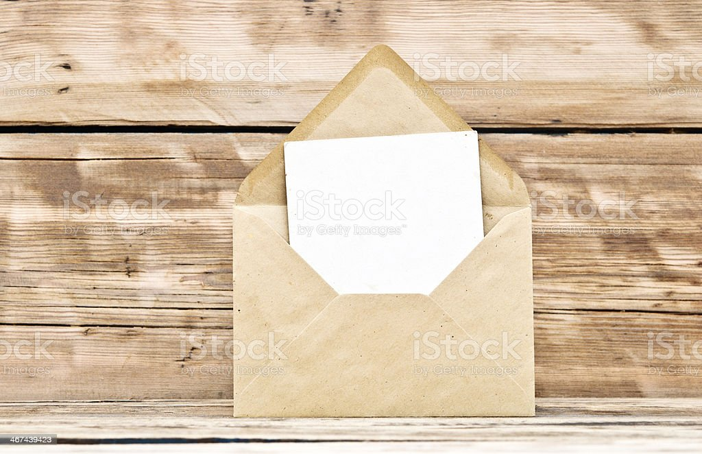Blank postcard and envelope on old wooden background stock photo