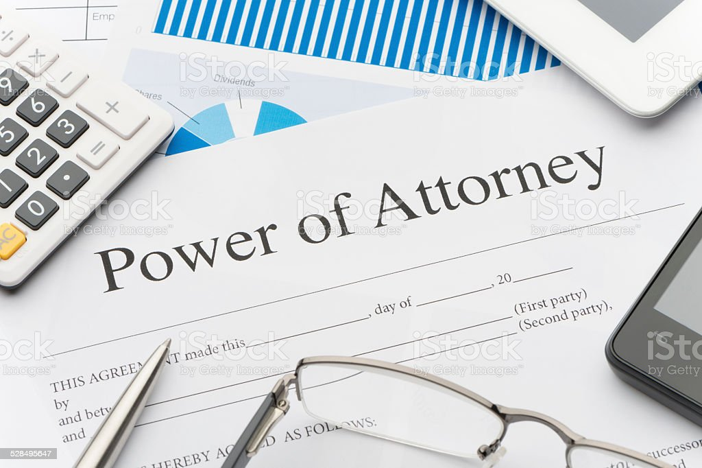 Blank power of attorney form with paperwork stock photo