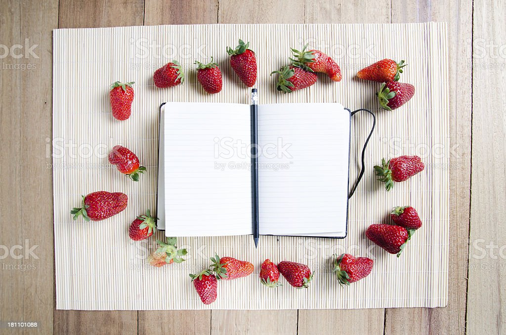 Blank recipe book surrounded by strawberries royalty-free stock photo