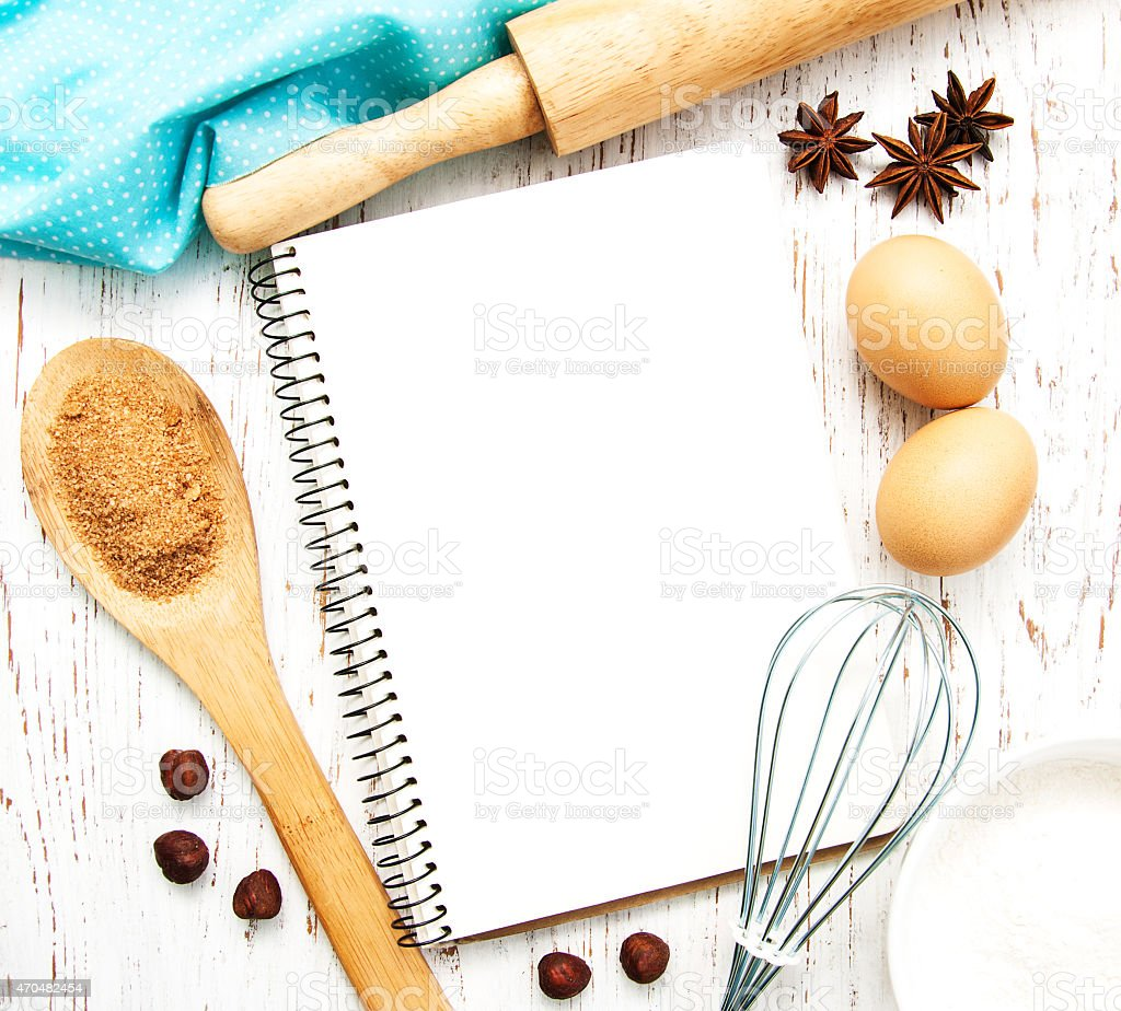 Blank recipe book with cooking utensils, spices and eggs stock photo