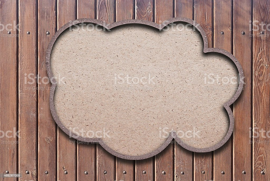 blank recycled paper speech bubble on wood background stock photo