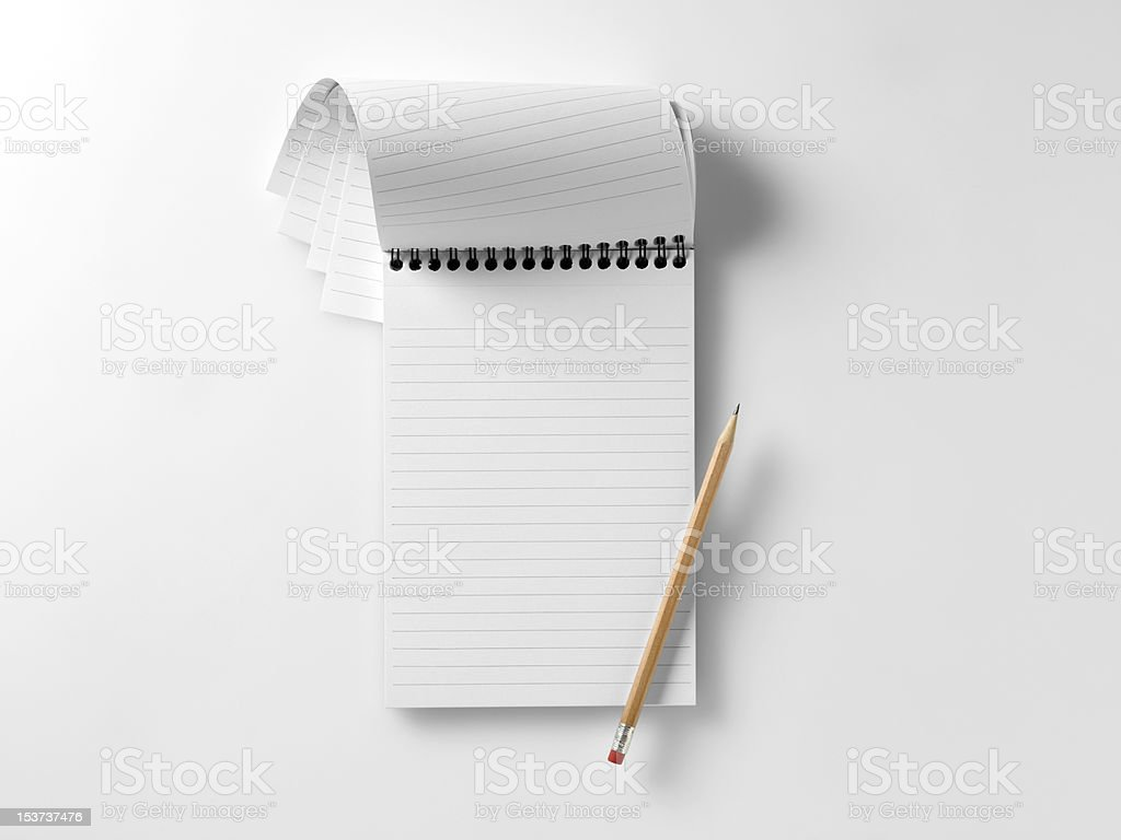 blank reporters notebook with pencil stock photo