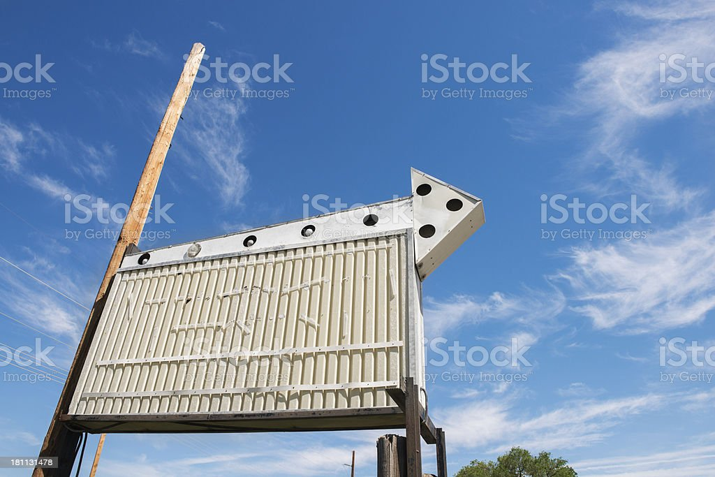 Blank Retro Sign with Arrow and Blue Sky royalty-free stock photo