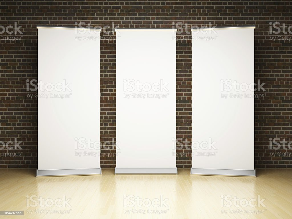 Blank roll up banner in studio stock photo