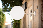 Blank round white signboard on the wall outdoor