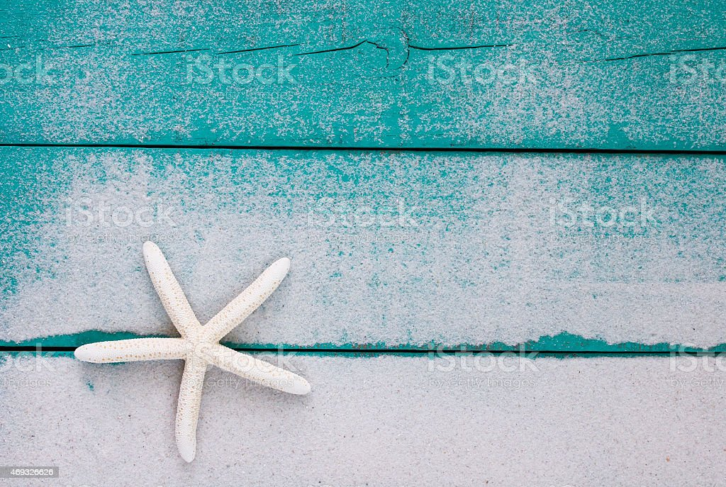Blank sandy blue wood sign with white starfish stock photo