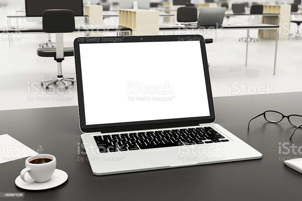 Blank screen on laptop with cup of coffee and glasses stock photo