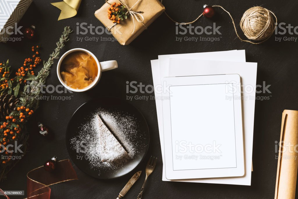 Blank screen tablet pc, cake and cofee, Christmas flat lay stock photo