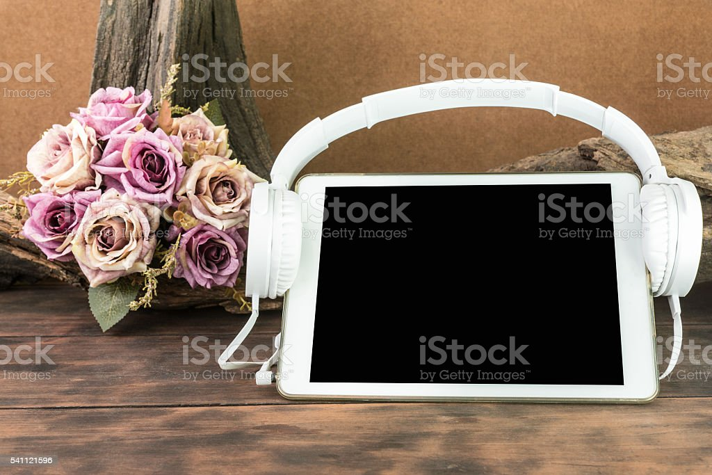 blank screen tablet with headphone stock photo