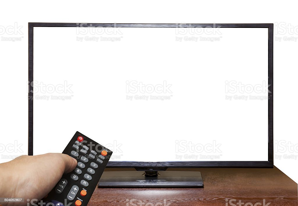 Blank screen TV on table and hand holding Remote Control stock photo