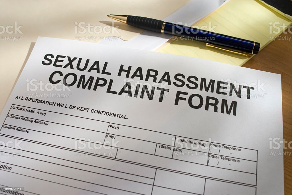 Blank Sexual Harassment Complaint Form and pen royalty-free stock photo