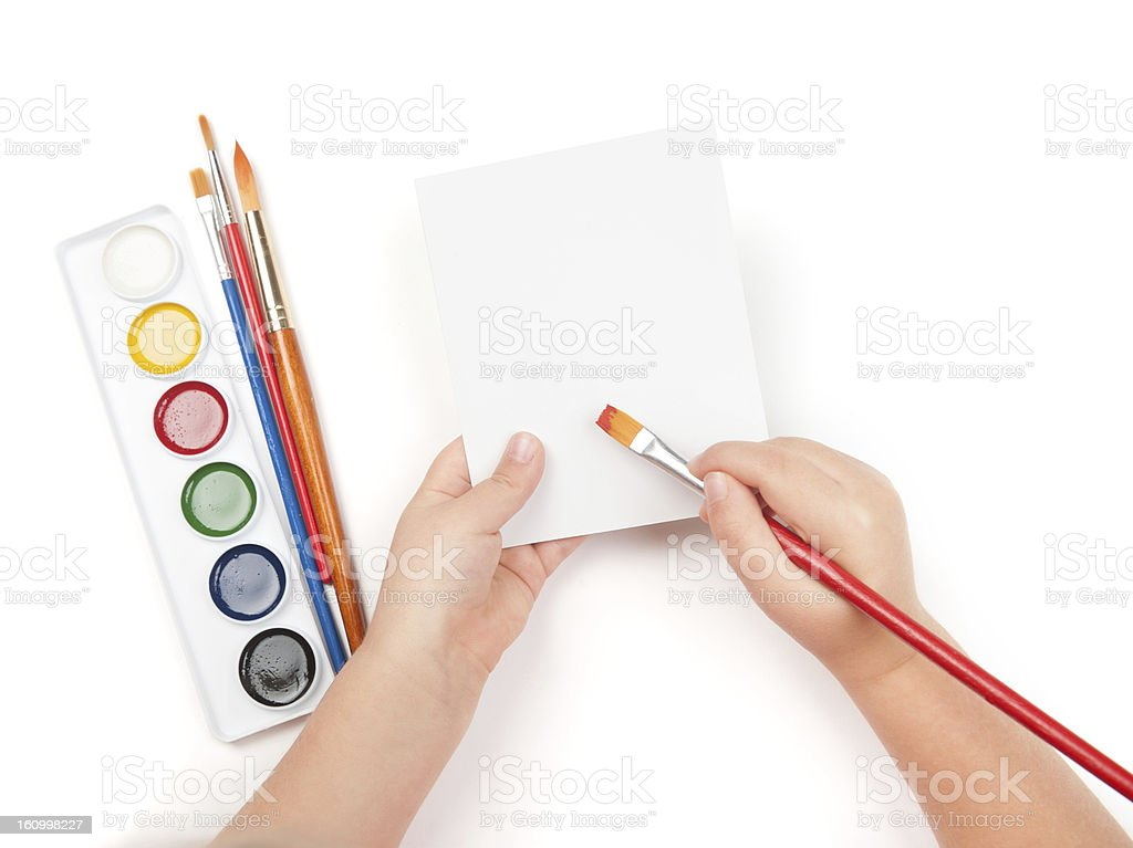 blank sheet in child hand with watercolor brush royalty-free stock photo