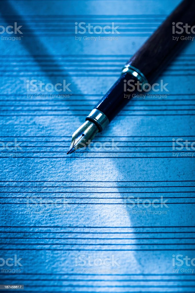 Blank sheet music with fountain pen stock photo
