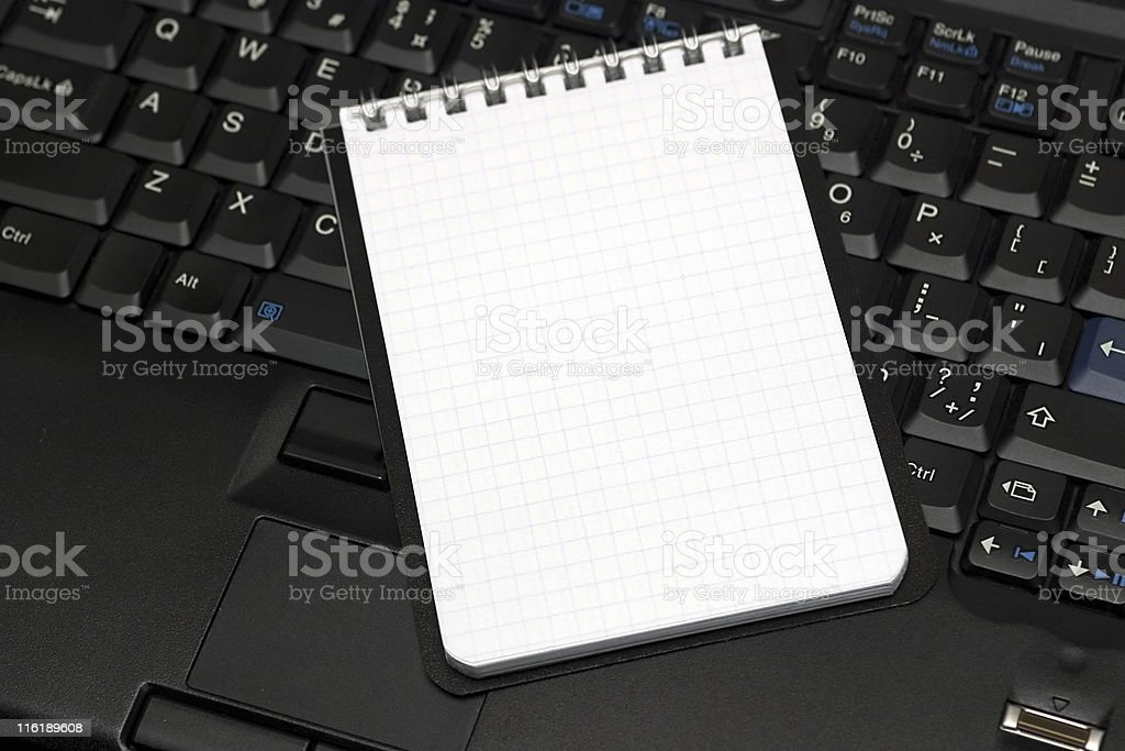 Blank sheet notebook and laptop royalty-free stock photo