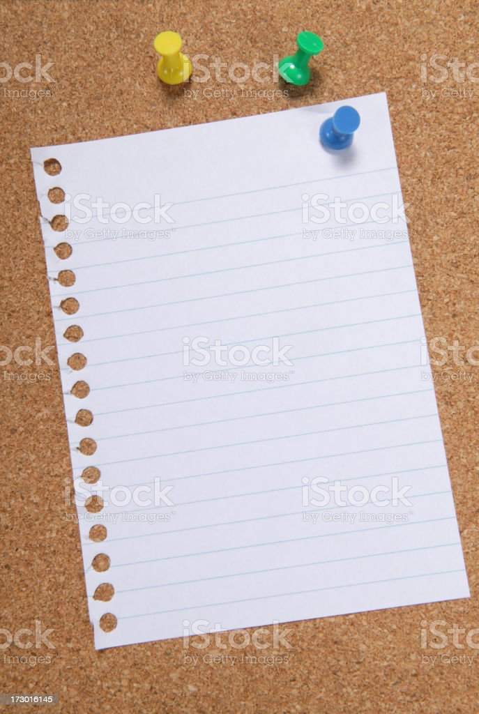 A blank sheet of paper pinned to a corkboard  stock photo
