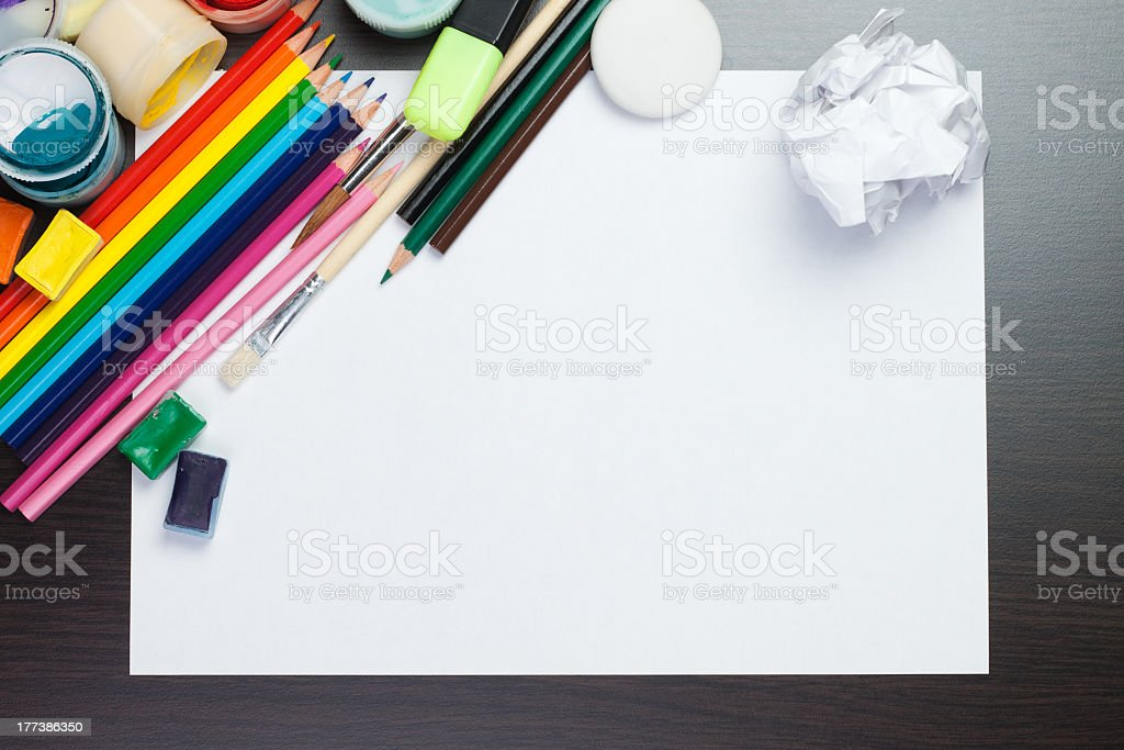 blank sheet of paper with colorful artist instruments creative process royalty-free stock photo