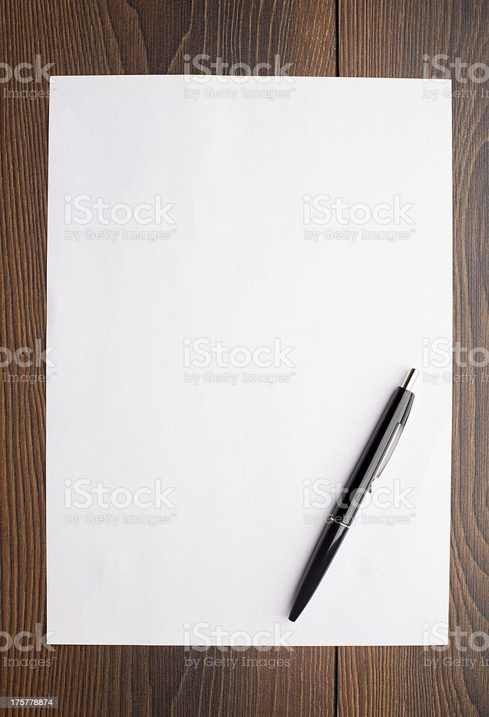 Blank sheet of white paper and pen stock photo