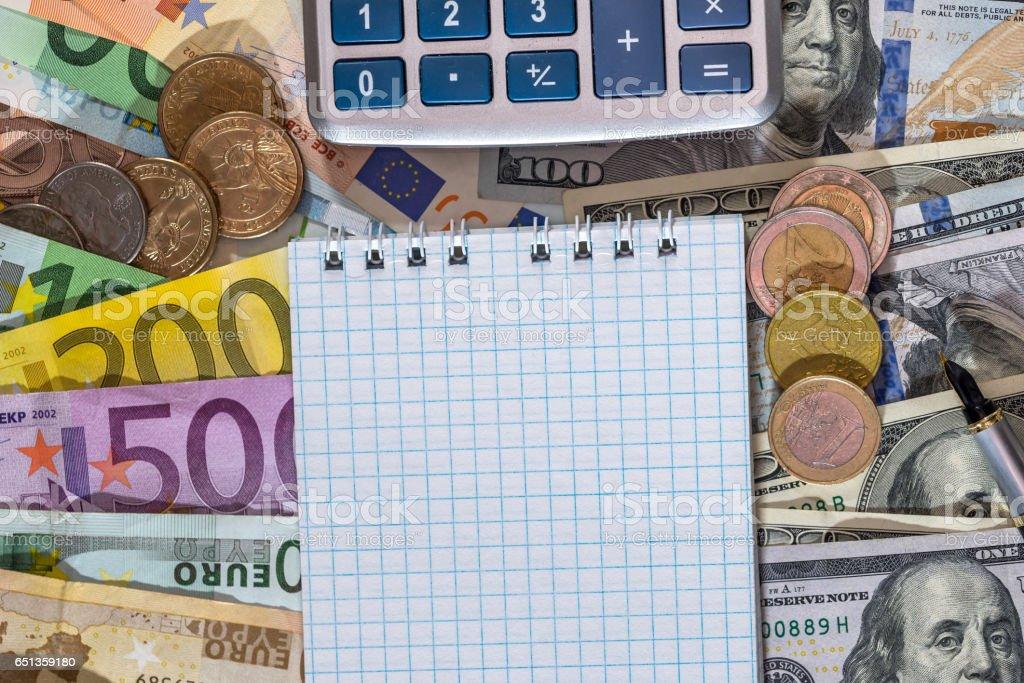 blank sheet with dollar, euros bills, coin. stock photo