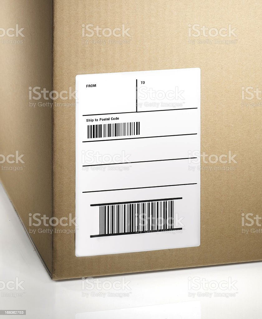 A blank shipping label on a package stock photo