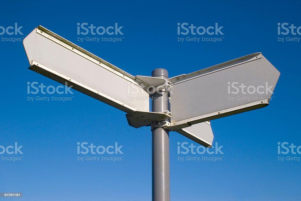 Blank sign against a clear blue sky stock photo