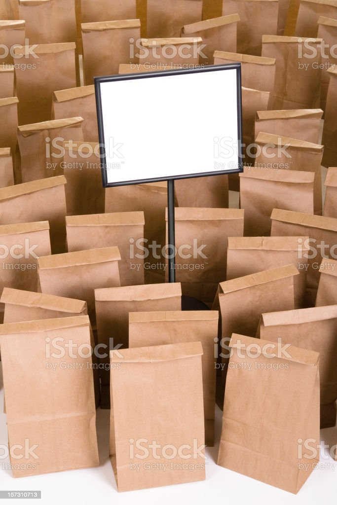 Blank Sign and Paper Bags royalty-free stock photo
