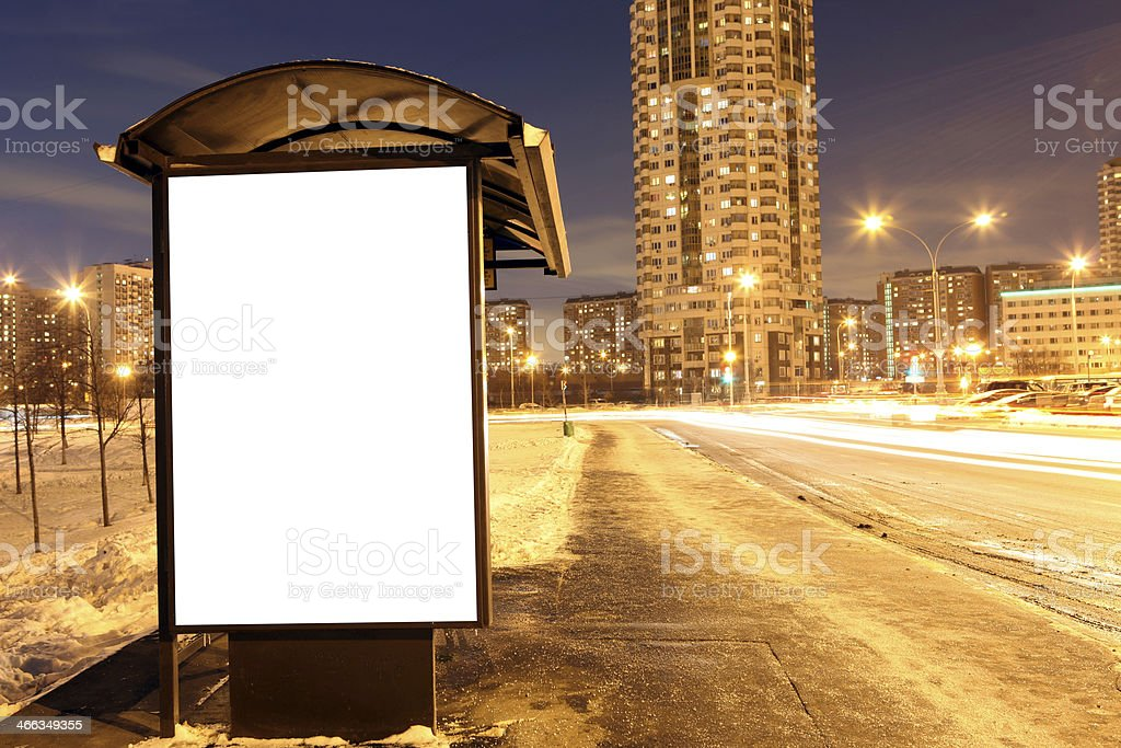 Blank sign at bus stop at evening in city stock photo